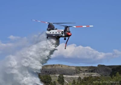 Ch-47 during aerial firefighting mission dumping water over fire
