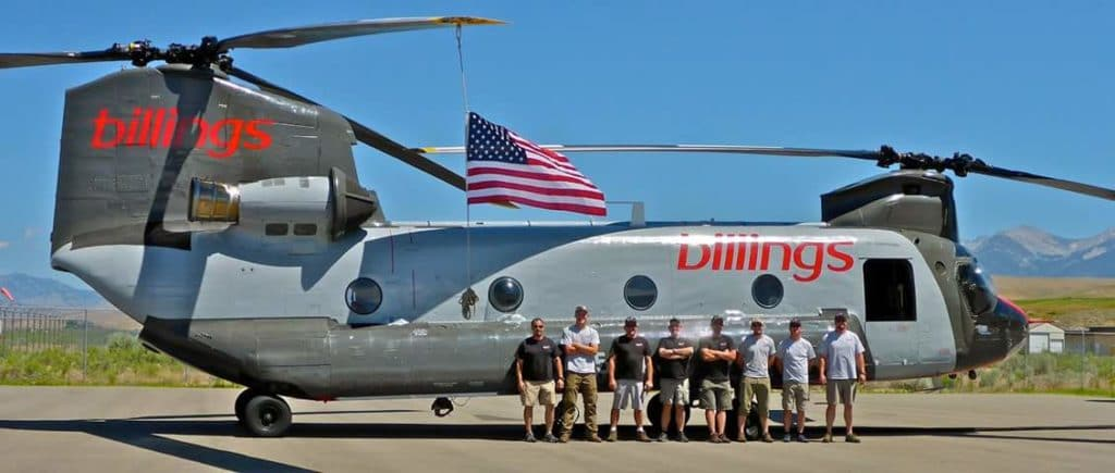 Crew of areial firefighters standing beside a CH-47