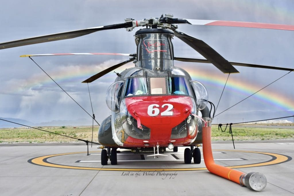 CH-47 Chinook Helicopter with fire fighting hose