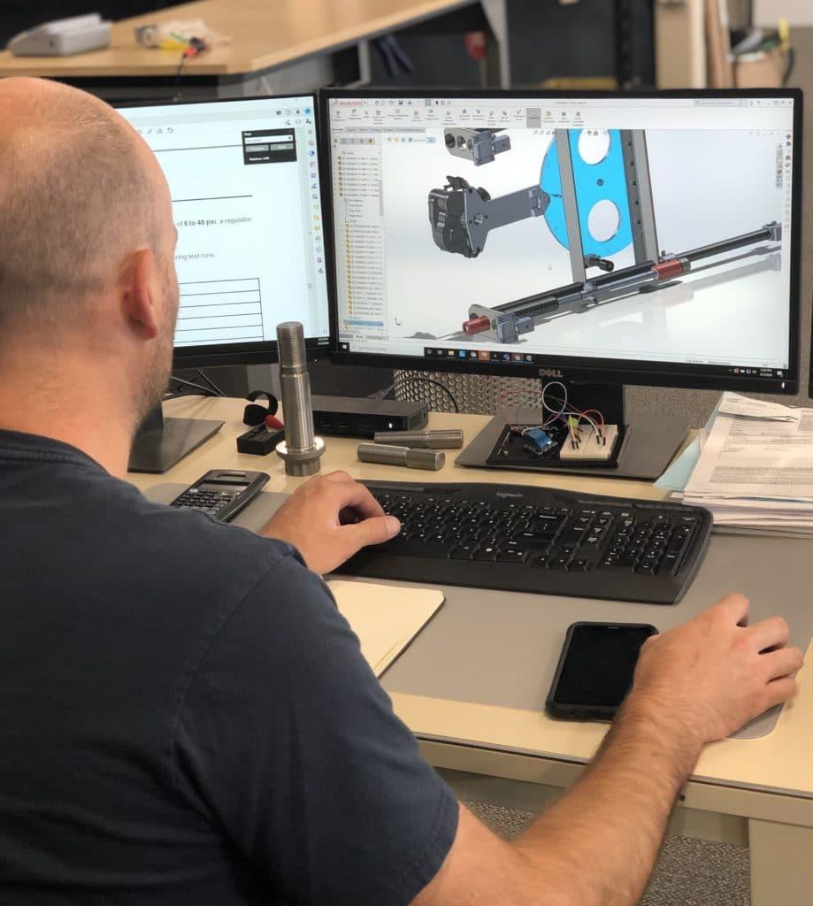 Engineering team working on CH-47D schematics